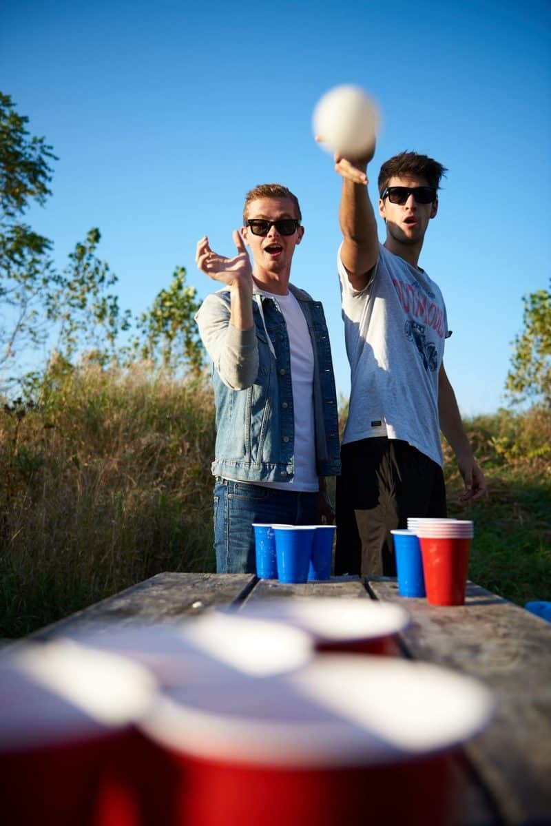 Boys playing beer pong