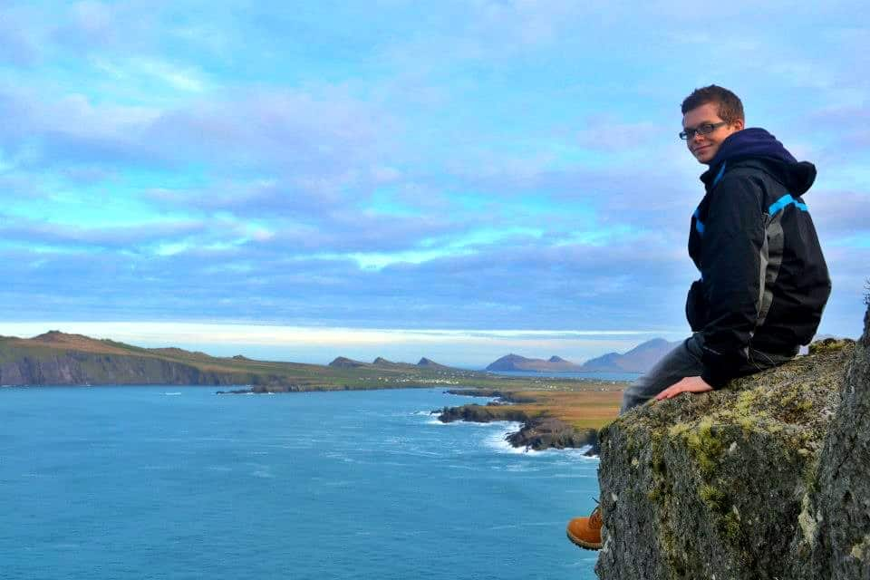 boy on edge of cliff ireland