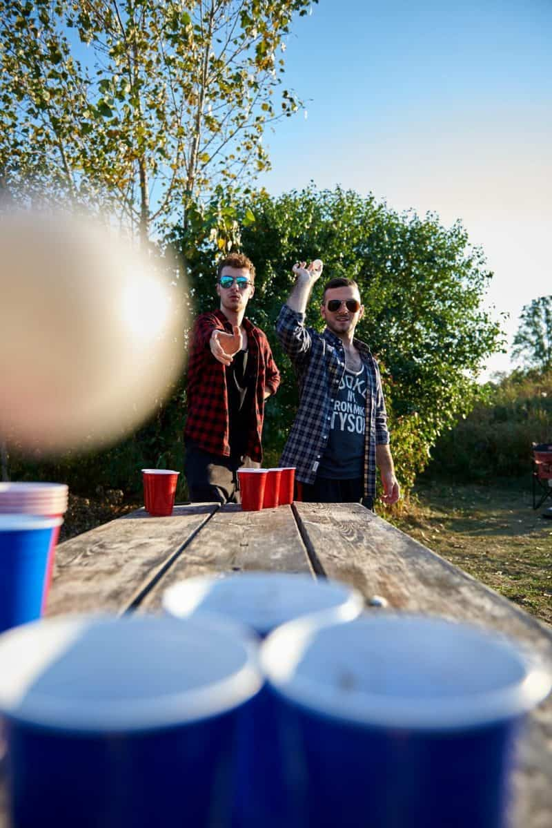 guys playing beer pong