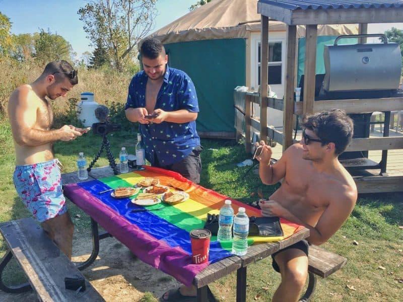Gays eating camp food